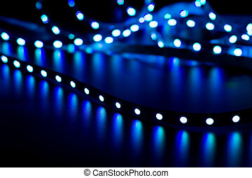 abstract background with glowing LED strip blurred in the...