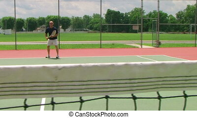Tennis Player Volleys 04 - Tennis player volleys using...