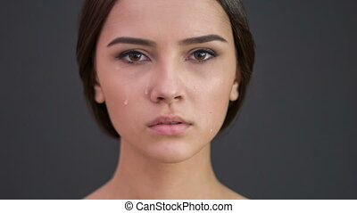 Young sad woman spills tears. - She is crying. Young...