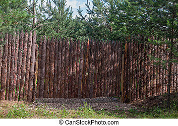 Fence stylized Palisade in the forest