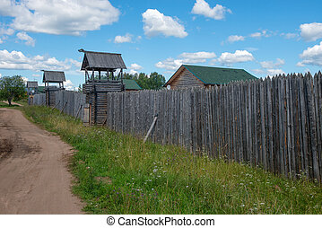 Fences palisade around the village with watchtowers
