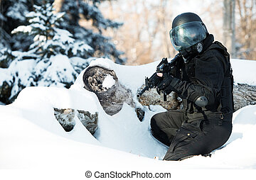 NATO soldier in winter uniform with the M4 machine gun on...