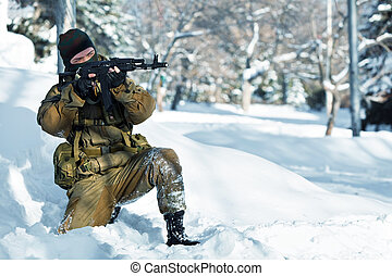 Russian soldier in winter uniform with the Kalashnikov...