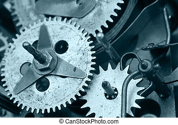 Gearwheels inside clock mechanism. Macro - Gearwheels inside...