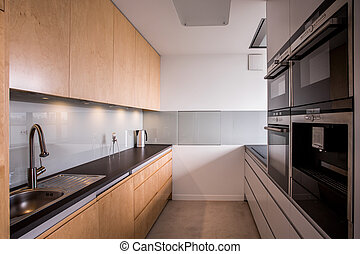 Wooden cupboards in stylish kitchen - Close-up of wooden...