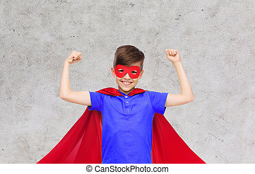 boy in red super hero cape and mask showing fists -...