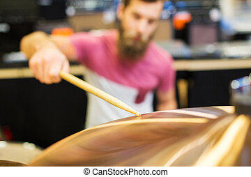 close up of male musician playing cymbals - music, sale,...