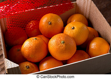 Clementines - Clementine oranges in packing crate.