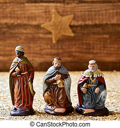 the three kings - closeup of the three kings carrying their...