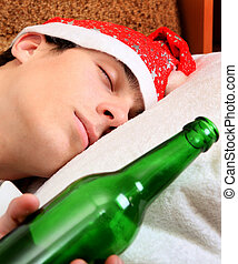 Young Man with Bottle of the Beer - Young Man sleep in Santa...