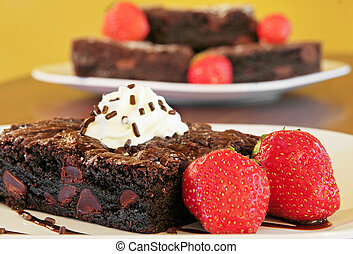 fudge brownies - a single fudge brownie with whipped topping...