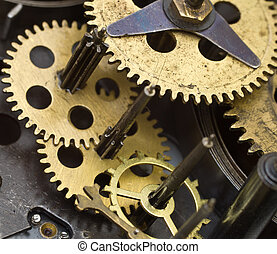 Gearwheels inside clock mechanism Concept Teamwork , Idea...