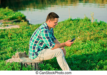 happy young man calling with mobile phone