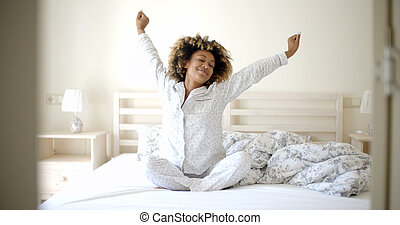 Young Woman Awaking On The Bed - Happy young woman waking up...