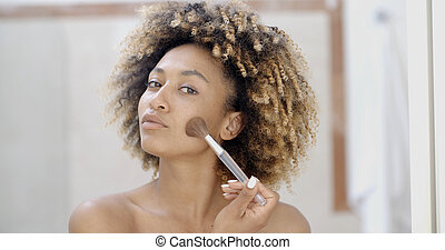Young Woman Putting Make Up - Portrait of young woman causes...