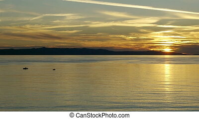 Calm sunset on Adriatic coast - Small boats on calm sea in...