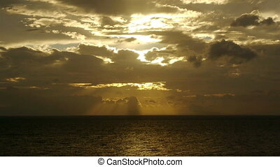 Light rays through clouds at sea - Landscape view at light...