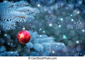 Red Cristmas ball isolated on grey bokeh background. - Blue...