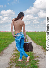 Attractive topless woman with suitcase
