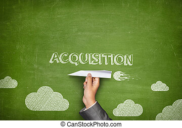 Acquisition concept on blackboard with paper plane -...
