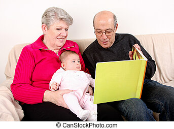 Family reading book to baby - Happy fun Caucasian Hispanic...