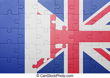 puzzle with the national flag of great britain and france ....