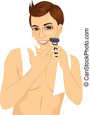 young man shaving with razor - portrait of handsome young...