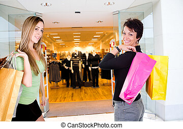 woman shopping in mall - woman standing in mall with...