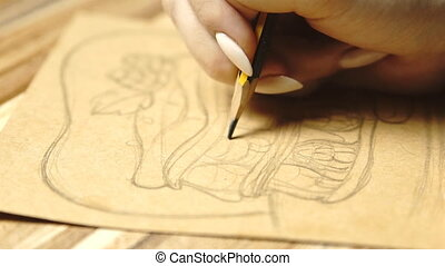 Lifestyle: hands of young beautiful girl freelance artist...