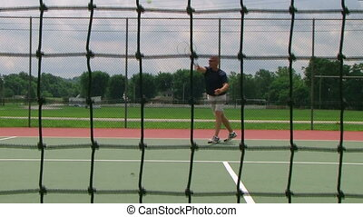 Tennis Player Volleys 03 - Tennis player volleys using...