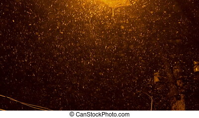 Snow Falling in Streetlight Beams at Night 1 - Snow Falling...