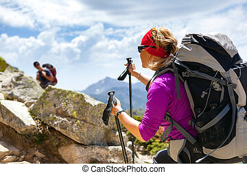 Couple hikers walking in inspirational mountains