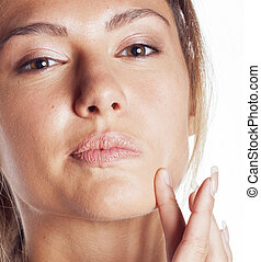 woman with pimple making out close up isolated on white...
