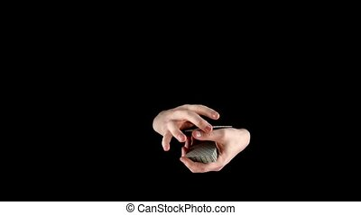 Hands of magician continue showing his trick with cards,...