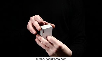 Talanted magician showing his trick with cards, like fan on...