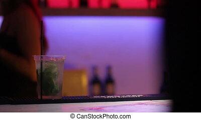 bartender prepare a mojito at nightclub - bartender prepare...