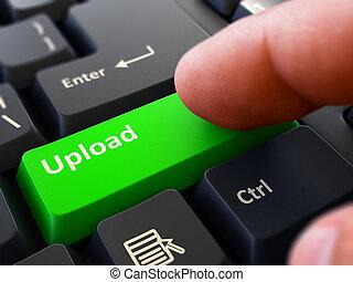 Pressing Green Button Upload on Black Keyboard. - One Finger...