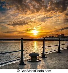 Santander Bay at sunset behind the fence - Santander Bay at...