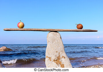 Apples into balance - Fresh apple and rotten in balance on...