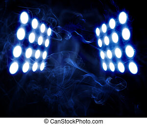 stage spot lights in artificial abstract smoke