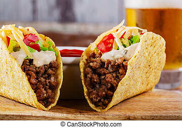 tacos with minced meat with greens