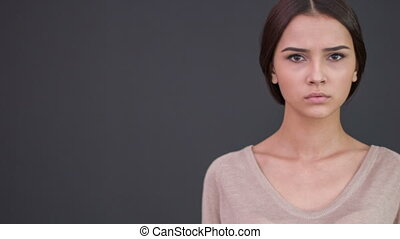 Young weary woman looks upset. - Unhappy mood. Young...