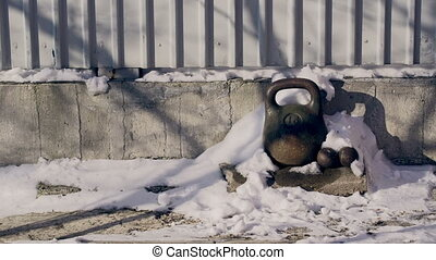 Abandoned Dumbbells Under Snow - Abandoned dumbbells covered...