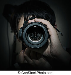 Portrait of photographer with camera