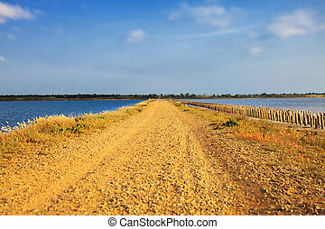 Isthmus that separates two lakes - Isthmus with a dirt road...