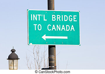 sign on the Canadian border, Calais, Maine, USA