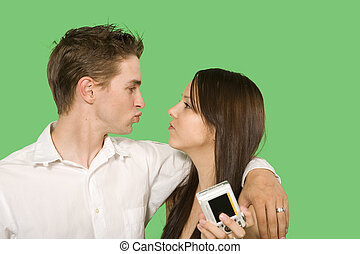green screen models - couple kissing holding digital camera...