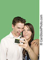 green screen models - happy couple taking pictures over...