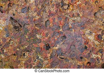 Laterite brick stone in rusty red c - Closeup texture...