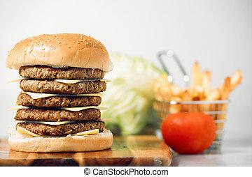 Mega Cheeseburger - Mega cheeseburger with potato chips and...